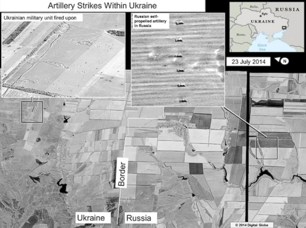PHOTO: The ODNI says that this slide shows self-propelled artillery only found in Russian military units, on the Russian side of the border, oriented in the direction of a Ukrainian military unit within Ukraine.
