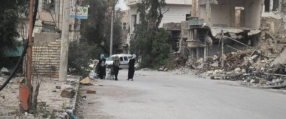 PHOTO: Women walk in downtown Deir Ezzor, which is largely enforced by Sharia law.