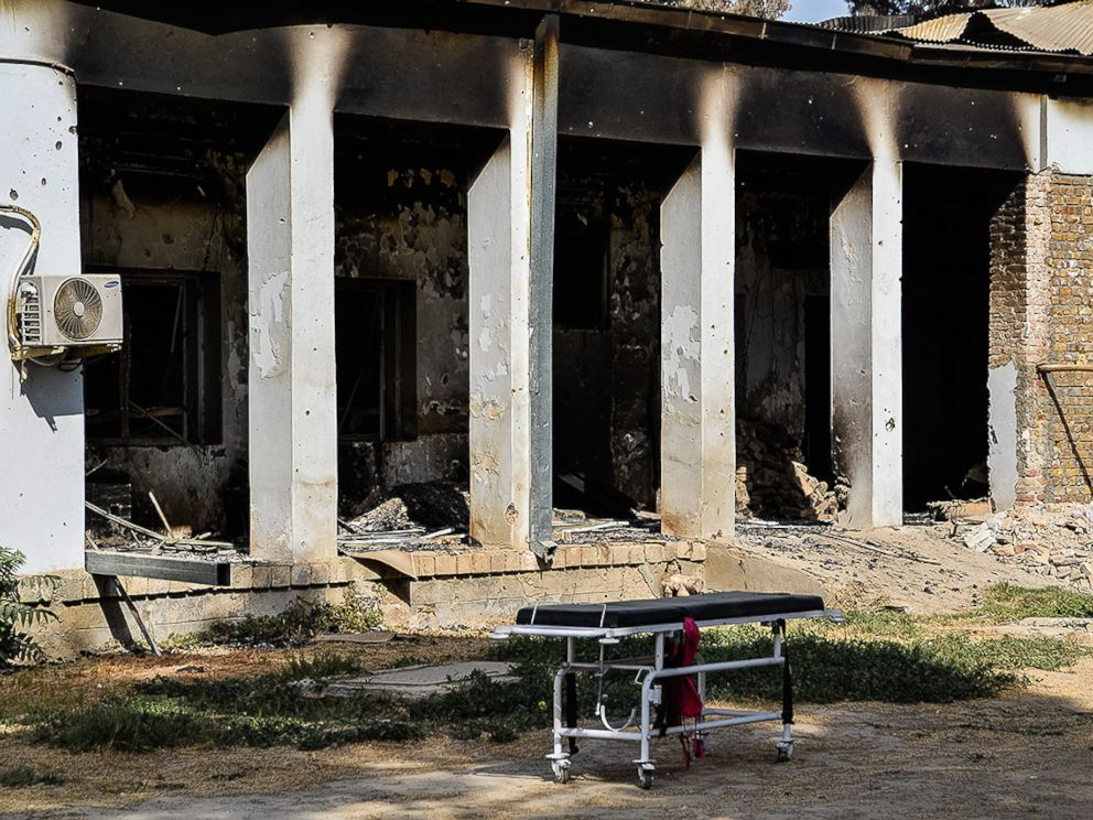 PHOTO:An emergency trolley bed lies abandoned in front of the heavily damaged entrance of the physiotherapy department. The hospital was hit by U.S. airstrikes on October 3, 2015.
