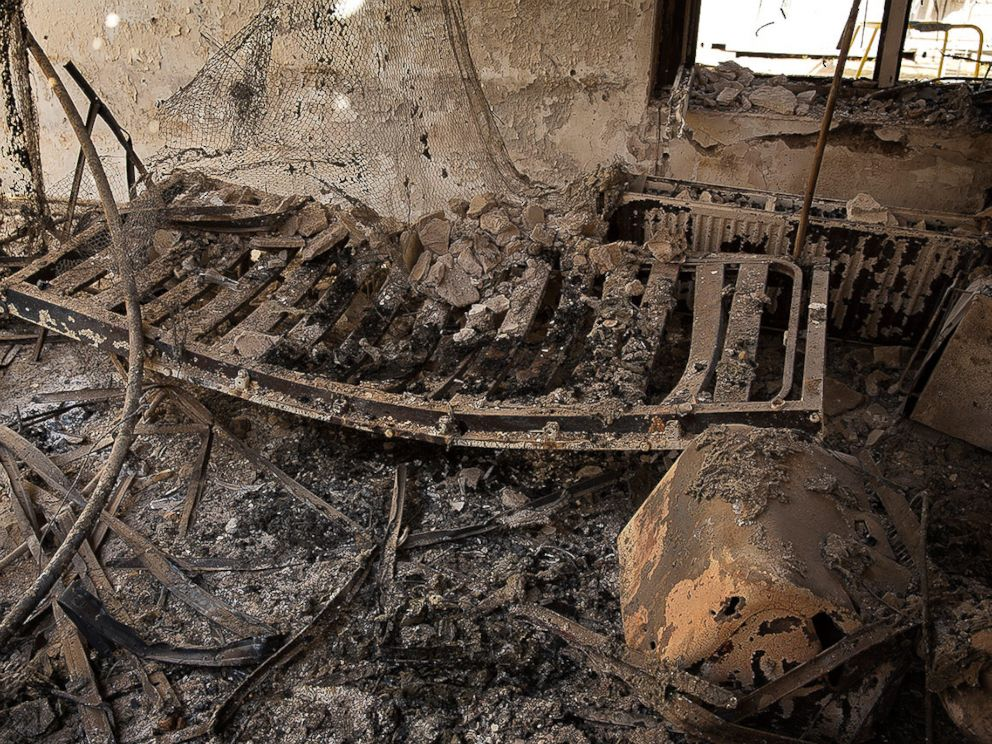 PHOTO: A charred and twisted bed-frame lies among ashes in a burnt room inside the MSF hospital in Kunduz hit by U.S. airstrikes on October 3, 2015.