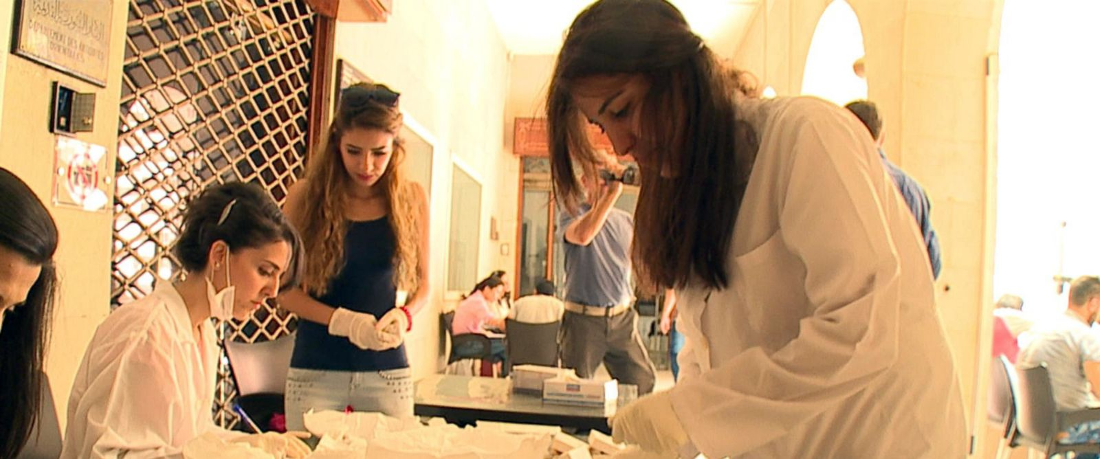 PHOTO: A group of young archaeologists are working to quickly document, measure and photograph every item in the National Museum of Damascus collection.