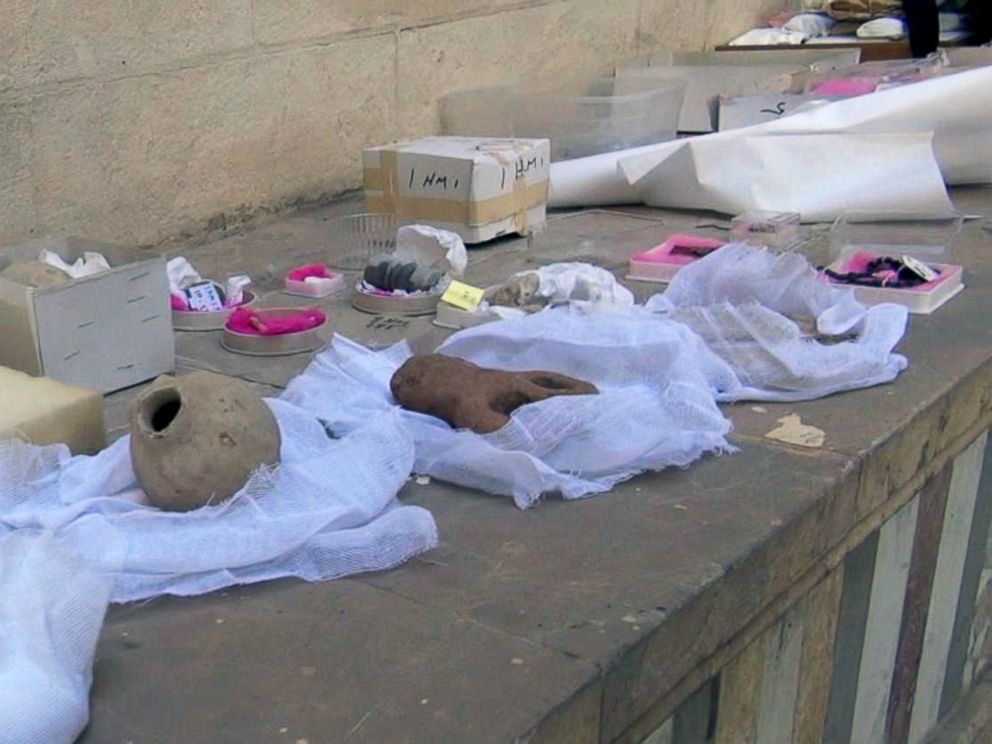 PHOTO: Ancient artifacts from the National Museum of Damascus collection are being packed away.