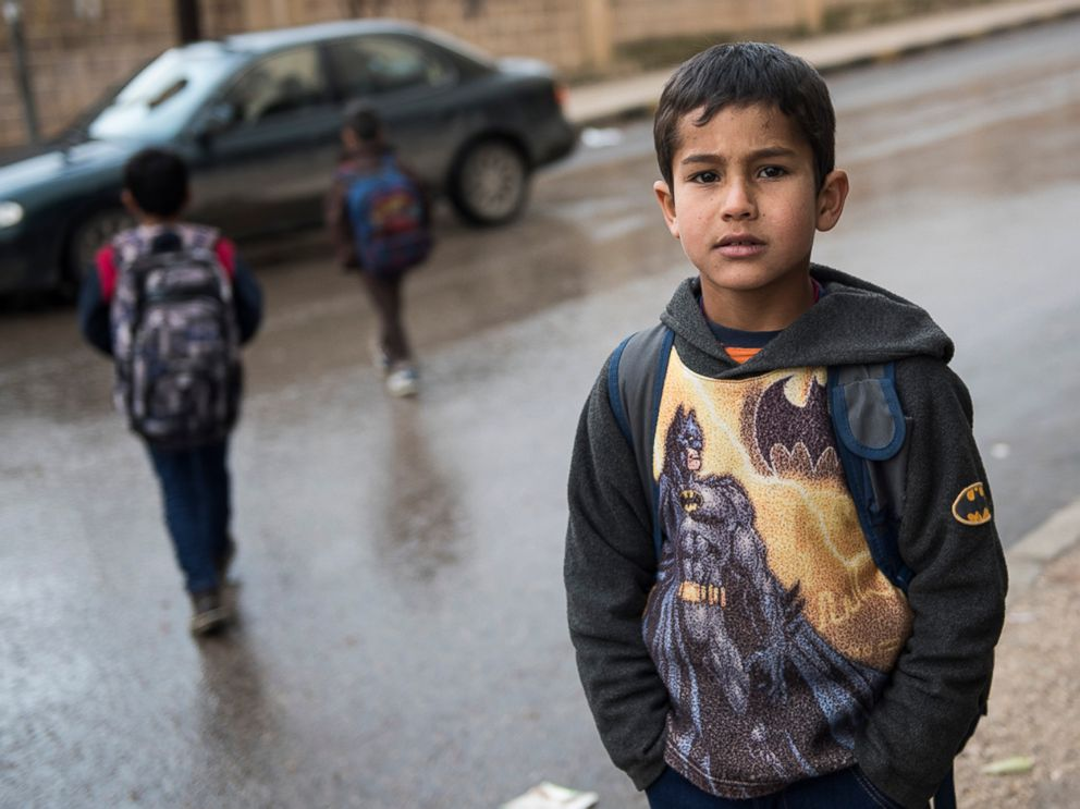 PHOTO: Zaher is eight years old and lives with his family in Irbid, Jordan. His family left Syria after the war broke out and they have received emergency cash assistance from CARE to help them with purchasing food.