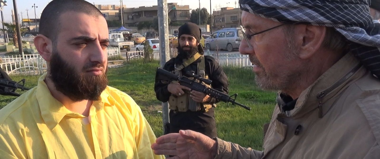 PHOTO: German journalist Jürgen Todenhöfer, right, seen speaking to a Kurdish prisoner, spent time with ISIS in Iraq and Syria.