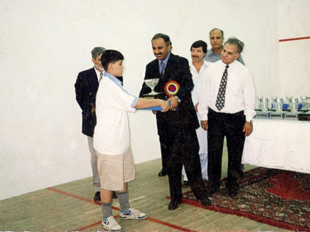 PHOTO: Maria Toorpakia became the best female squash player in Pakistan after years of playing as a boy. Here is she seen receiving her first squash trophy. First place, Under 13 Hashim Khan Junior Squash Champtionship.