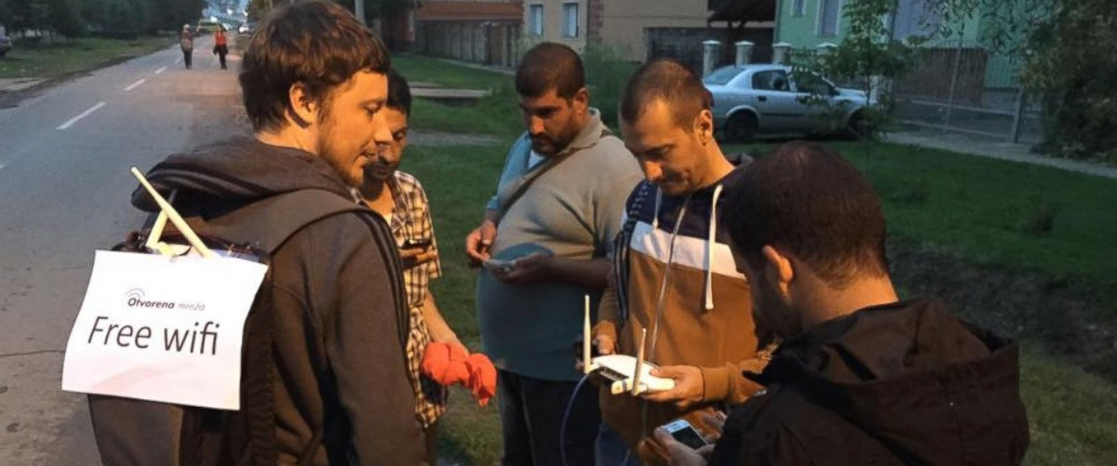 PHOTO:Project Open Network volunteer talking with refugees and migrants in Tovarnik, Croatia, on September 20th.