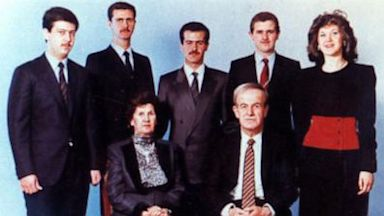 PHOTO: The Assad family. Hafez al-Assad and his wife, Mrs. Anisa Makhlouf. On the back row, from left to right: Maher, Bashar, Basil, Majid, and Bushra al-Assad.