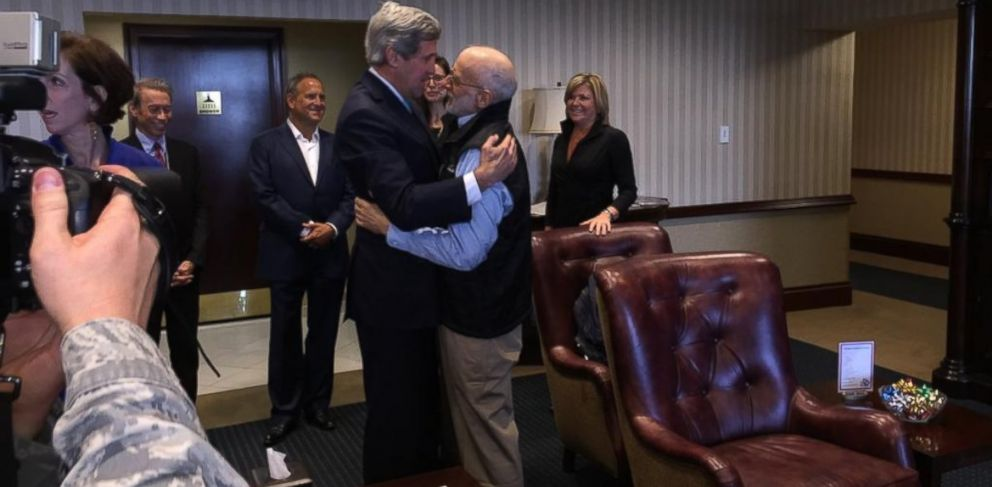 PHOTO: @JohnKerry embraces #AlanGross at Joint Base Andrews, Dec. 17, 2014.