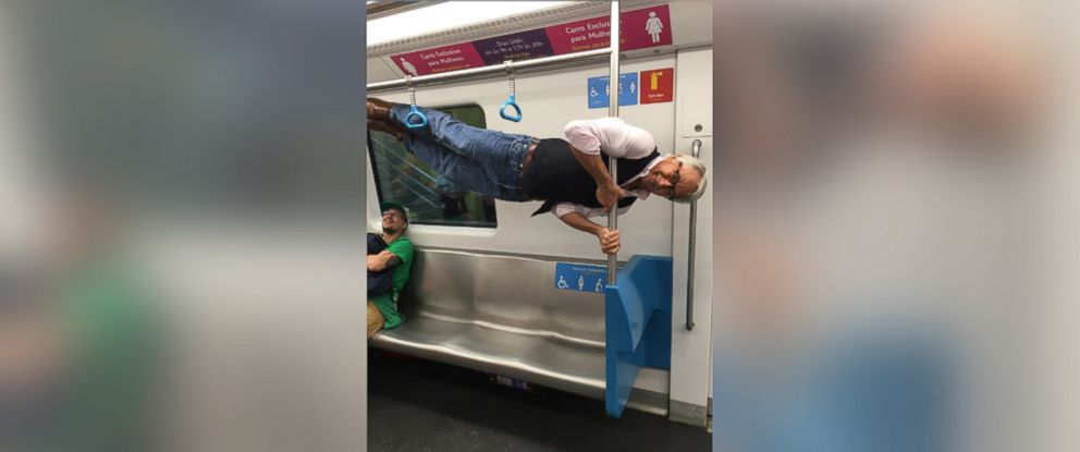 PHOTO: A photo of a 68-year-old grandfather stunt on a Rio de Janeiro subway went viral on Twitter.