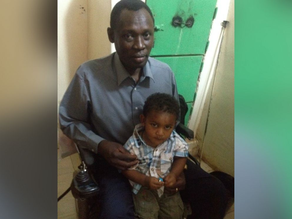 PHOTO: Daniel Wani, with son Martin, after a visit to see his wife, Meriam Ibrahim, in Sudan, May 29, 2014.