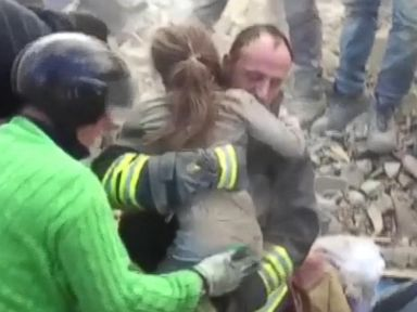 PHOTO: Rescuers pulled a girl from underneath debris in Pescara del Tronto, Italy, after being buried for nearly 17 hours,