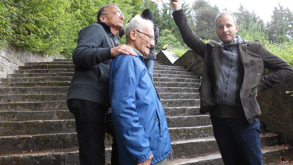 PHOTO: Pal Ferenczi (center) with his family during a visit to the concentration camp in Mauthausen, Austria, where he was once a prisoner. He recalled being forced to carry rocks up and down these steps.