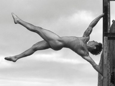 PHOTO: World Champion free runner Tim Sheiff becomes a naked human flag across a bridge in central London.
