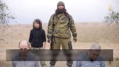 "PHOTO: A video released by ISIS Jan. 13, 2015 claims to show a child killing two Russian ""spies."""