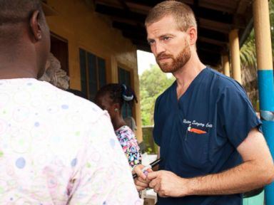 PHOTO: Dr. Kent Brantly speaks with a worker outside the ELWA Hospital in Monrovia, Liberia
