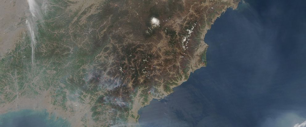 PHOTO: NASA has released satellite images of North Korea, taken on April 25, 2014, showing large fires burning in wooded areas all across the country.