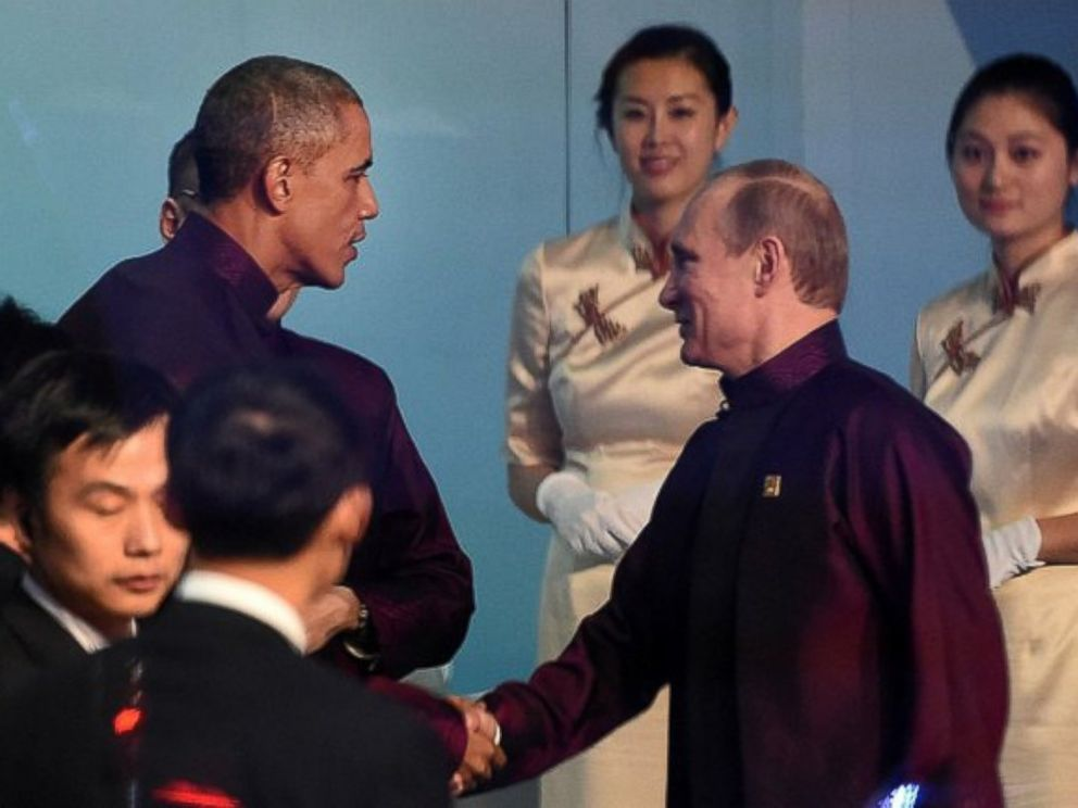 PHOTO: The Kremlin released a photo of President Putin smiling as President Obama greeted him before the APEC class photo, Nov. 10, 2014, in Beijing.