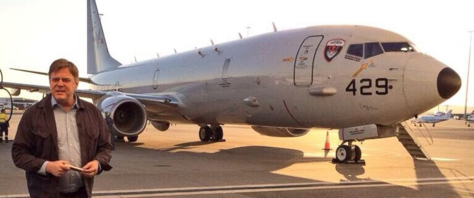 PHOTO: David Wright in front of a P-8 Poseidon search plane.