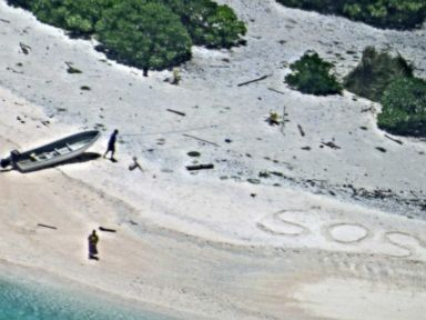 PHOTO: Two mariners who wrote SOS in the sand after being stranded on an uninhabited Pacific island in Chuuk State, Federated States of Micronesia were rescued, Aug. 26, 2016.