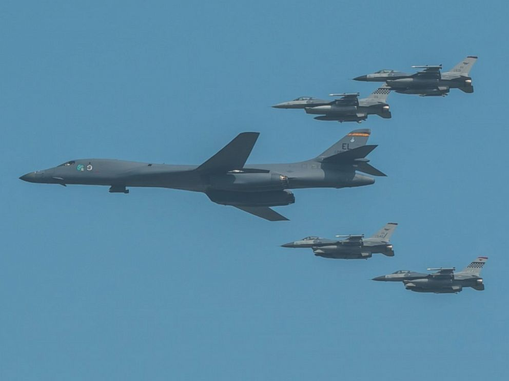 PHOTO: A U.S. Air Force B-1B Lancer, escorted by U.S. Air Force F-16 Fighting Falcons, performs a flyover over Osan Air Base, in South Korea, Sept. 13, 2016.