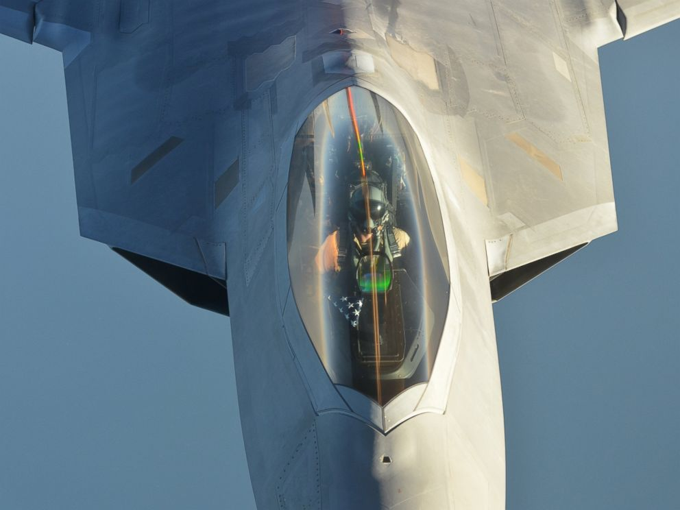 PHOTO: A U.S Air Force KC-10 Extender refuels an F-22 Raptor fighter aircraft after strikes in Syria