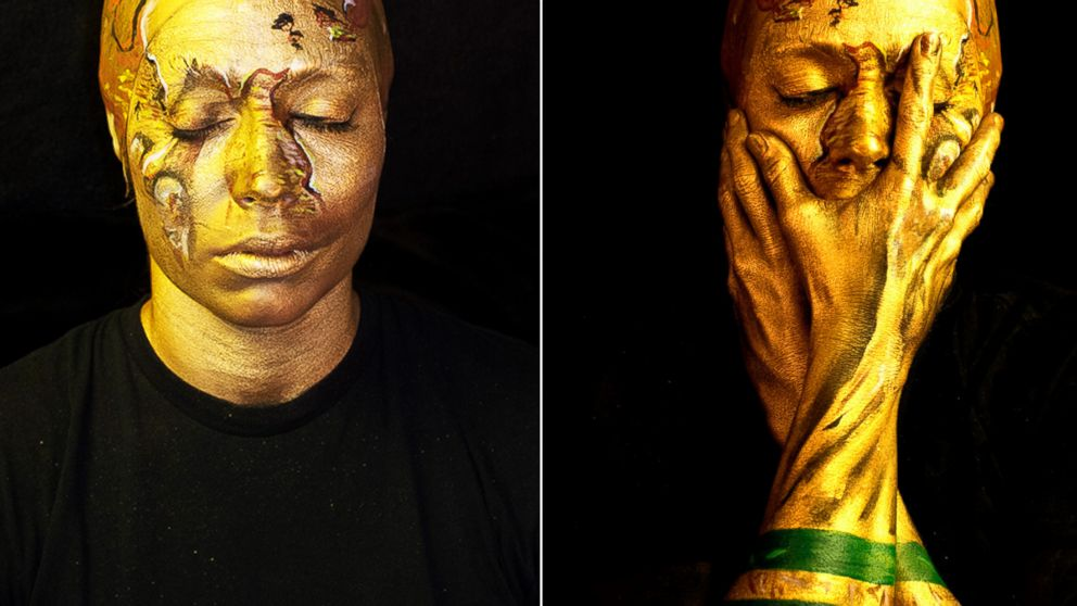 PHOTO: London Artist Emma Allen transformed herself into the World Cup trophy.