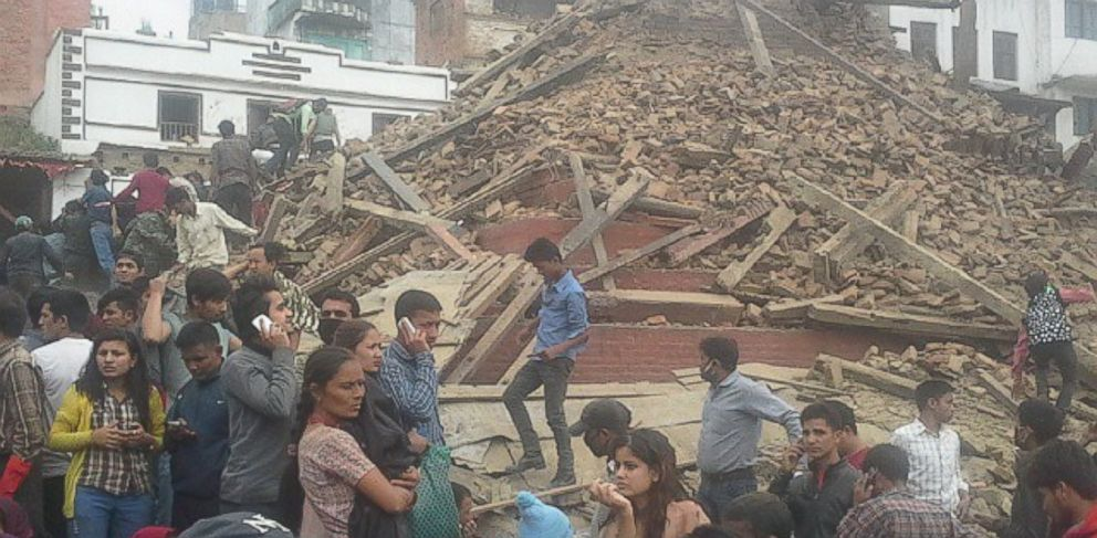 PHOTO: A collapsed building in Kathmandu after an earthquake strikes Nepal.