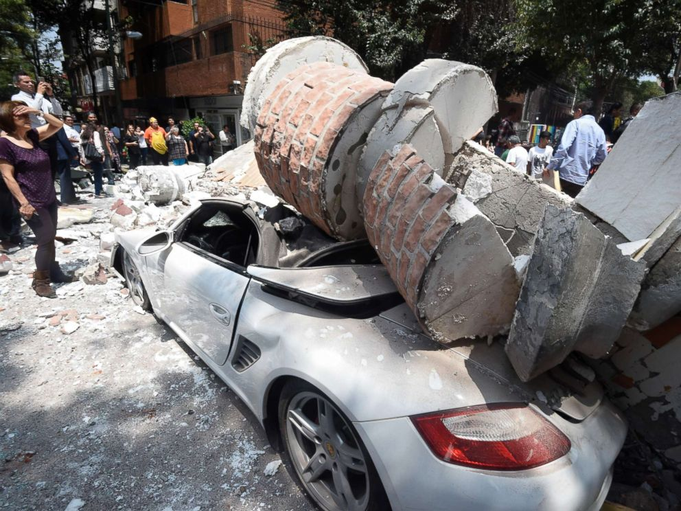 PHOTO: A car parked on the street in Mexico City sits under debris from a damaged building after a 7.1 earthquake rattled Mexico City on September 19, 2017.