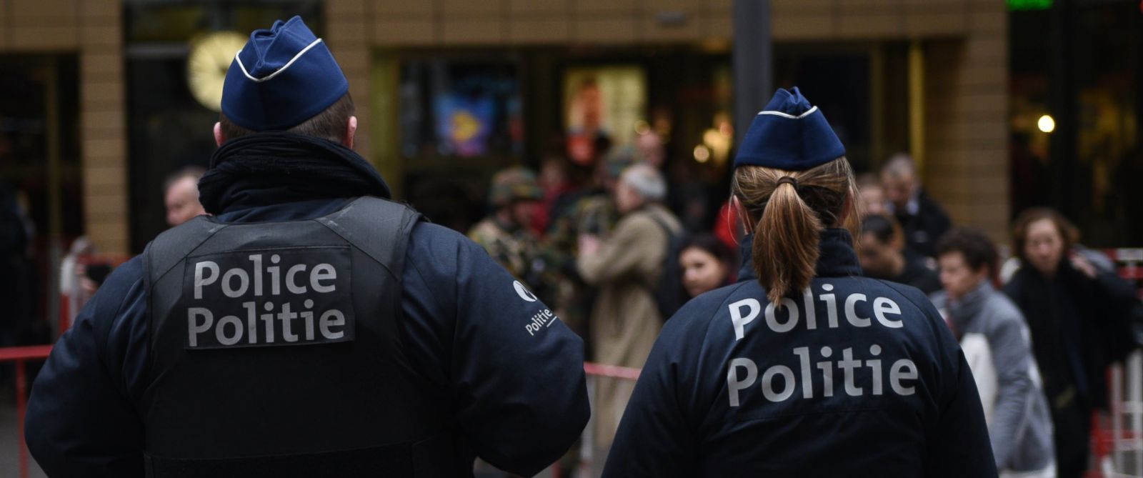 PHOTO: Police officers stand outside a rail station in central Brussels, March 24, 2016.