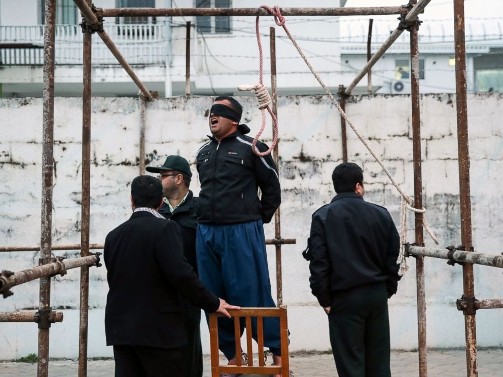 PHOTO: Balal, who killed Abdolah Hosseinzadeh in a street fight with a knife in 2007, reacts as he stands in the gallows during his execution ceremony in Nowshahr, Iran, April 15, 2014.