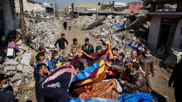 PHOTO: Residents pile up body bags in the back of a pick up truck after recovering it from the rubble where there were reported coalition air strikes in the Mosul al-Jadida neighborhood of Mosul, March 24, 2017.