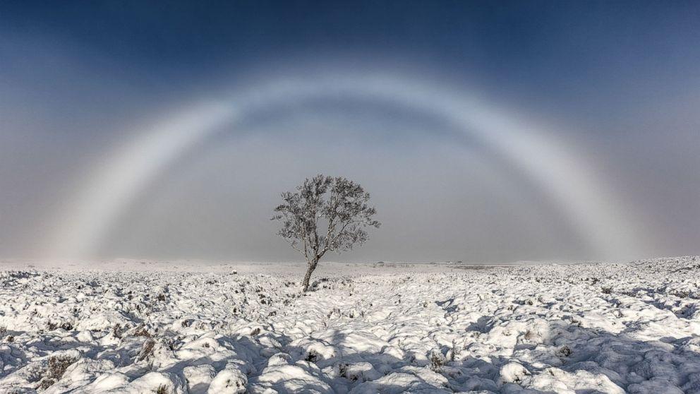Lovely white rainbow snapped over Scottish moor