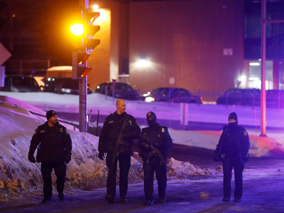 PHOTO: Police officers patrol the perimeter near a mosque after a shooting in Quebec City, Jan. 29, 2017.