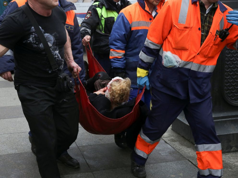 PHOTO: An injured person is helped by emergency services outside Sennaya Ploshchad metro station, following explosions in two train carriages at metro stations in St. Petersburg, Russia, April 3, 2017.