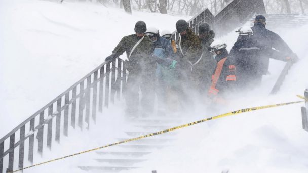 PHOTO: Japan Self-Defense Forces soldiers carry victims after an avalanche hit a group of high school students and teachers climbing near a ski resort, north of Tokyo, Japan, March 27, 2017.