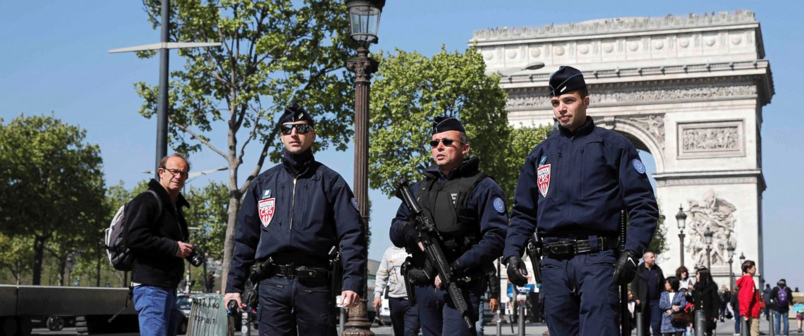 PHOTO: French CRS police patrol the Champs Elysees Avenue the day after a policeman was killed and two others were wounded in a shooting incident in Paris, France, April 21, 2017.