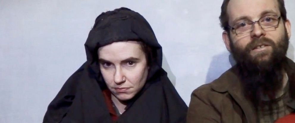 PHOTO: A still image from a video posted by the Taliban on social media, Dec. 19, 2016, shows American Caitlan Coleman next to her Canadian husband Joshua Boyle and their two sons.