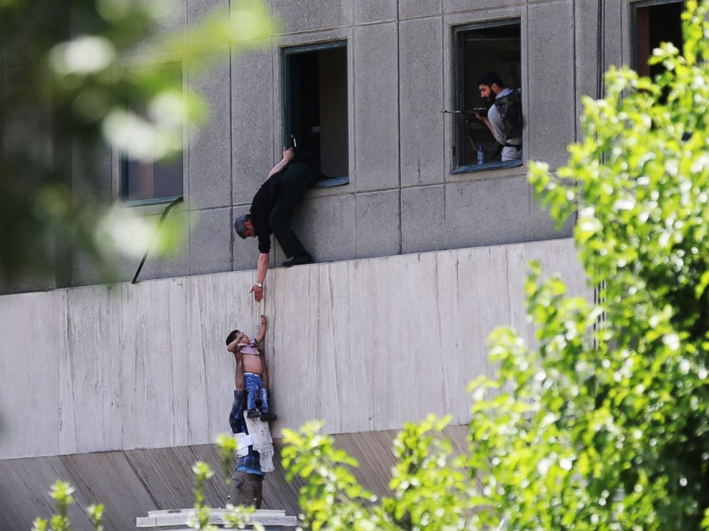 PHOTO: A boy is evacuated during an attack on the Iranian parliament in central Tehran, Iran, June 7, 2017.