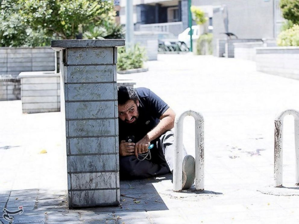 PHOTO: A man takes cover during an attack on the Iranian parliament in central Tehran, Iran, June 7, 2017.