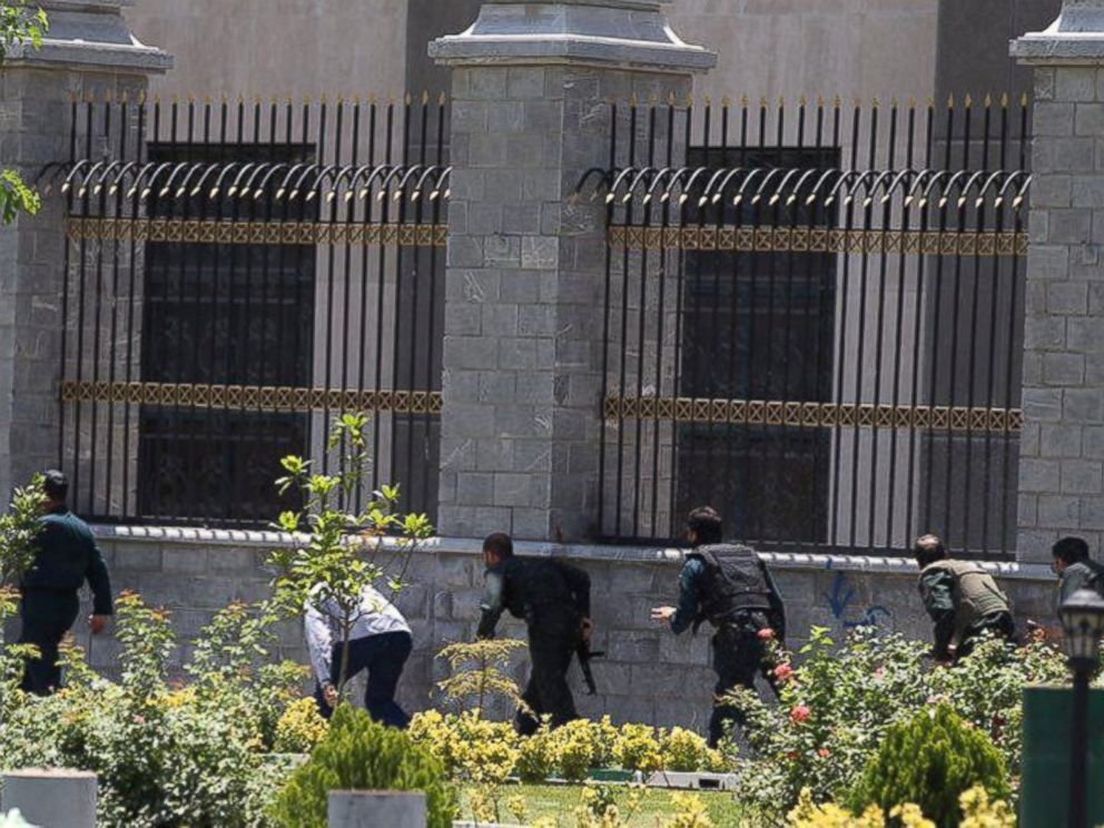 PHOTO: Members of Iranian forces run during an attack on the Iranian parliament in central Tehran, Iran, June 7, 2017.