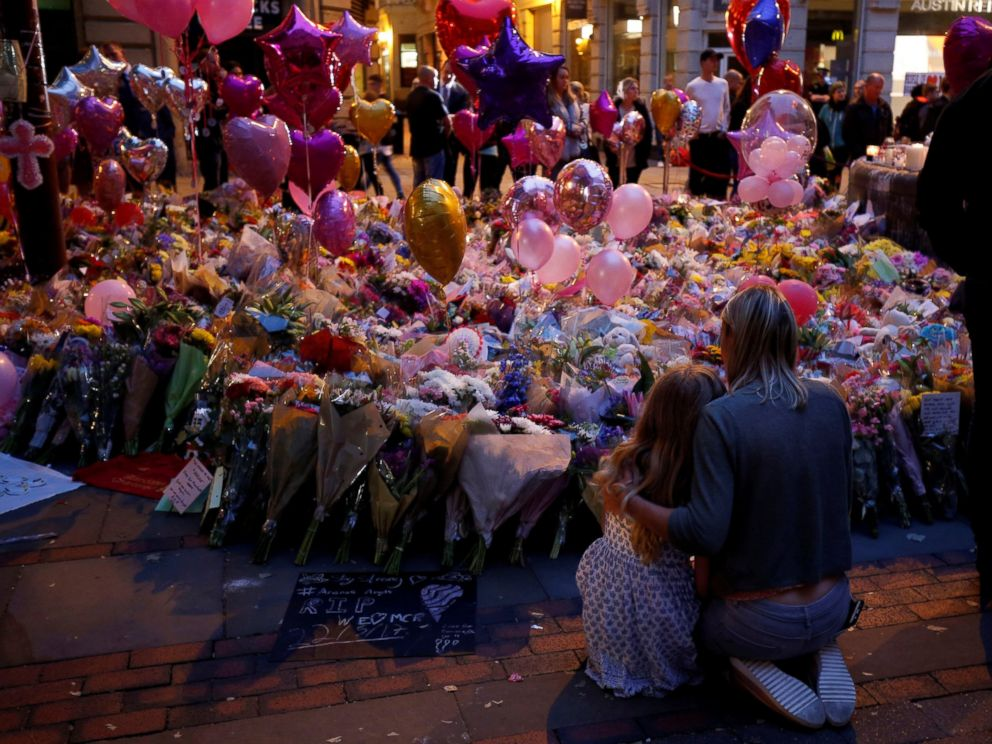 PHOTO: People attend a vigil for the victims of last weeks attack at a pop concert at Manchester Arena, in central Manchester, Britain May 29, 2017.