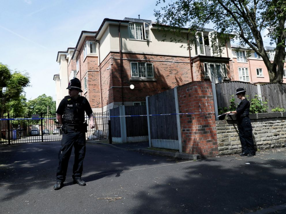PHOTO: Police officers stand outside a residential property near to where a man was arrested in the Chorlton area of Manchester, England, May 23, 2017.