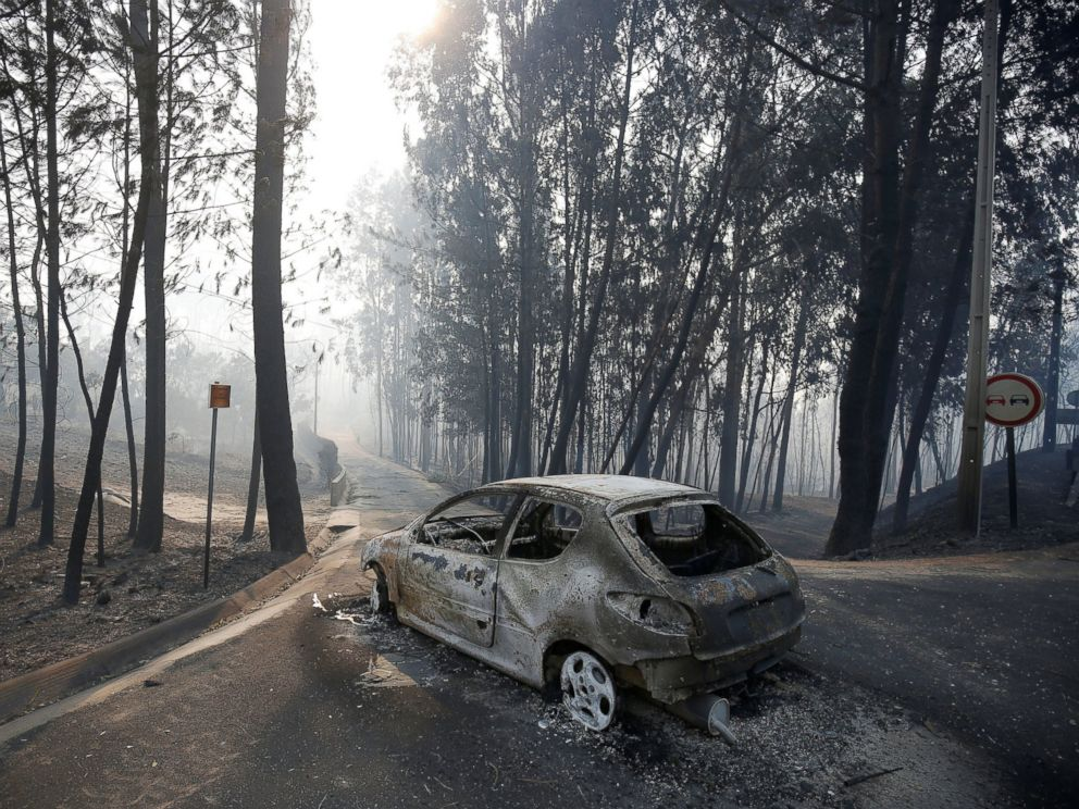 PHOTO: A burned car is seen in the aftermath of a forest fire near Pedrogao Grande, in central Portugal, June 18, 2017.
