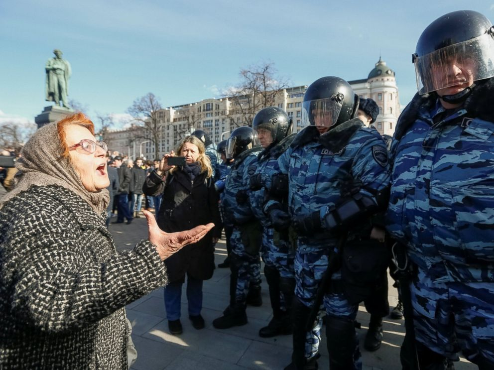 PHOTO: A woman argues with law enforcement officers as they block a rally in Moscow, Russia, March 26, 2017.