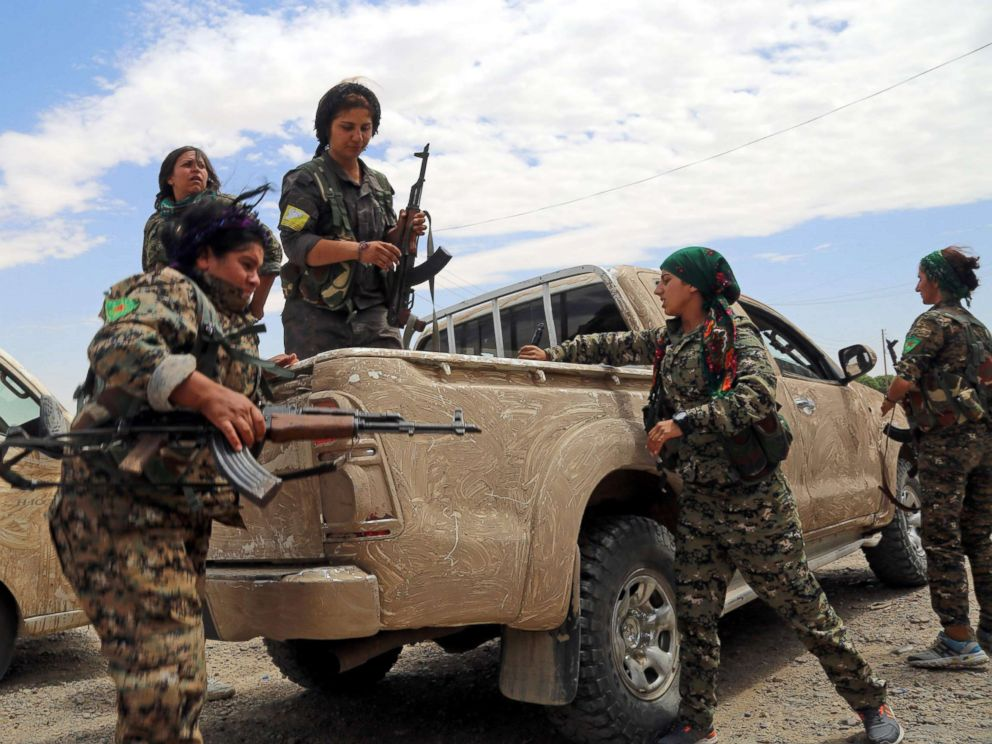 PHOTO: Members of the Syrian Democratic Forces (SDF), made up of an alliance of Kurdish and Arab fighters, take position a neighborhood on the eastern front of ISISs Syrian bastion of Raqqa after seizing the area from the jihadists, June 14, 2017.