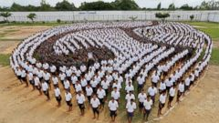 PHOTO: Male inmates form the Thai symbol for the number nine, in honor of late Thai King Bhumibol Adulyadej, also known as King Rama IX, at the Central Correctional Institution for Young Offenders in Pathum, Bangkok,Thailand, Oct. 27, 2016.
