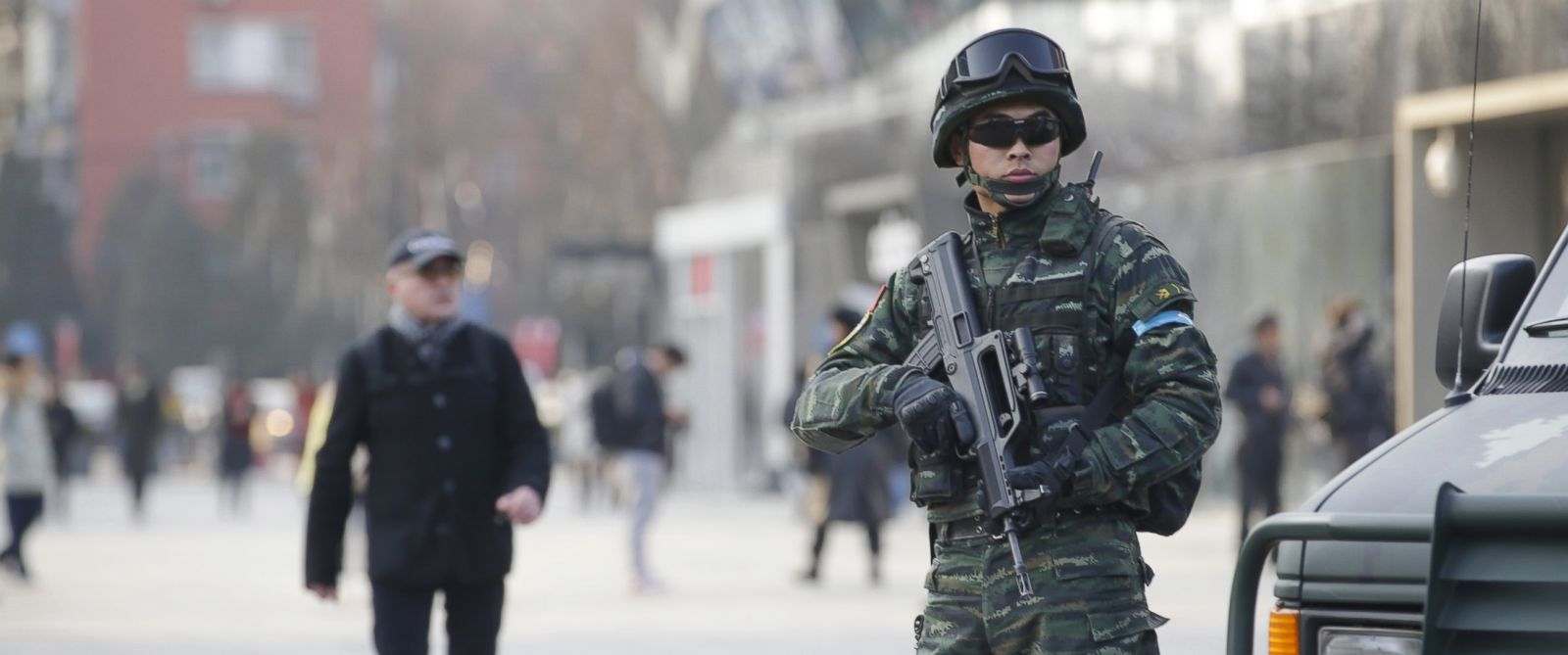 PHOTO: An armed policeman of the Snow Leopard Commando Unit stands guard near a police van at the Sanlitun area, a fashionable location for shopping and dining, in Beijing, Dec. 24, 2015.