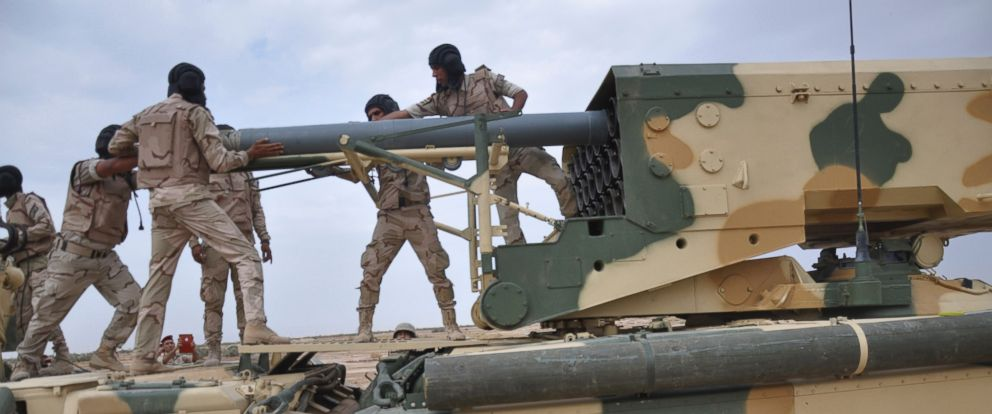 PHOTO: Iraqi Army soldiers work in a Russian-made multiple rocket launcher known as the TOS-1A during training at a military camp in Baghdad, Oct. 14, 2014.