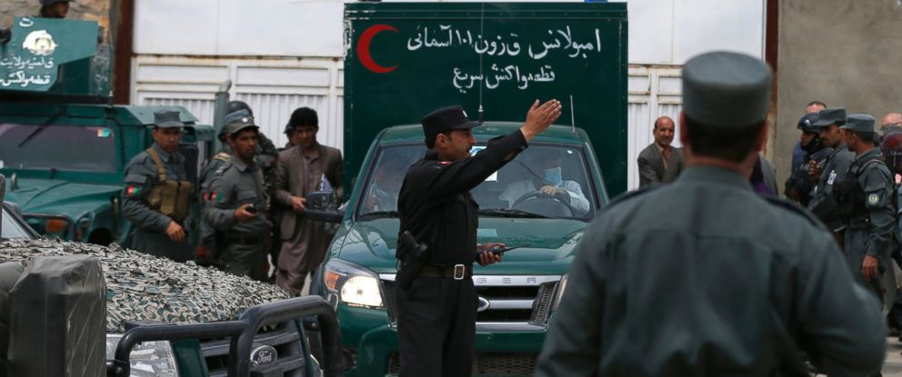 PHOTO: An ambulance leaves Cure Hospital after three foreigners were killed in Kabul, April 24, 2014.