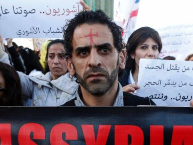 PHOTO: Assyrians hold banners as they march in solidarity with the Assyrians abducted by Islamic State fighters in Syria earlier this week, in Beirut on Feb. 28, 2015.